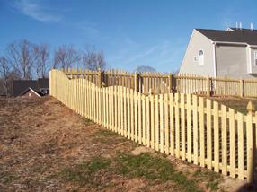 Wood split rail, arched picket style.